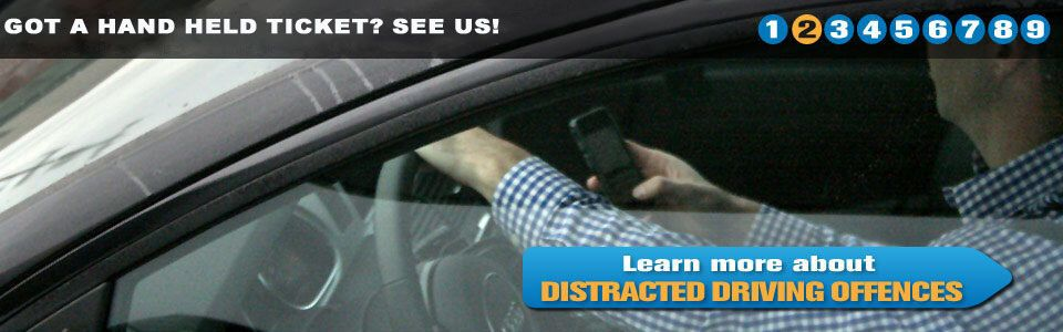 a person checking his phone while driving